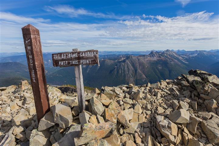 Caution sign on ridge